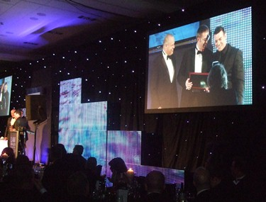 Brian Inkster presented with Chairman's Award on screen - Law Awards of Scotland 2013