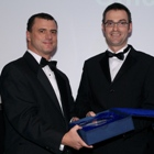 Brian Inkster receives the Innovation Award from Russell Thomson of British Waterways
